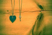Vintage Valentine,   Heart And Key On Rustic Grunge  Cracked Wood For Valentines Day Background