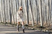 Beautiful Blonde Girl, Dressed With Beige Dress, Walking In A Rural Road
