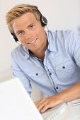 Salesman with headset in conference call