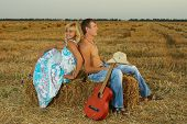 A Pair Of Lovers In The Hay With Guitar