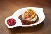 pic of duck breast  - Delicious duck breast dish with rice and chutney served in classy restaurant - JPG