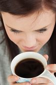 Brunette on the verge to drink a cup of coffee