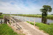 Wooden Bridge In Dutch National Park Weerribben