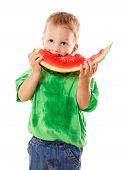 Little boy eating a watermelon