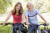 picture of 13 year old  - Teenage Boy And Girl On Bicycles - JPG