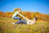 Young romantic couple have a fun in park. Autumn set.