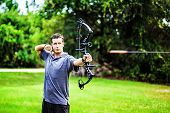 foto of archer  - Close up picture of an archer with a bow - JPG