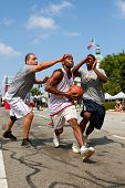 Man Drives To The Basket In Outdoor Street Basketball Tournament