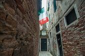 Italian National Flag In Narrow Street, Venice