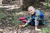 foto of face-fungus  - The joyful boy has found an aspen mushroom in wood - JPG