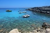 pic of aquamarine  - Kavo Greko cape with ships in Cyprus - JPG