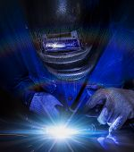 stock photo of welding  - Worker welding the steel part by manual - JPG