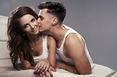 stock photo of foreplay  - Handsome man and sexy woman in bed - JPG