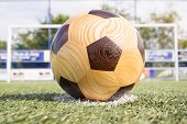 Wooden football on penalty spot