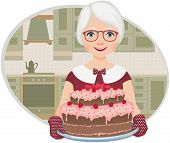 picture of stereotype  - Grandmother in the home kitchen holding a tray with a cake - JPG