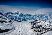 stock photo of wilder  - Aerial View of the Headwaters of a Beautiful Glacier in the Great Alaskan Wilderness - JPG