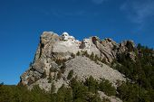 foto of mount rushmore national memorial  - A distant view of Mount Rushmore in South Dakota - JPG