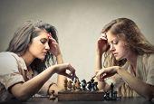 beautiful women playing chess