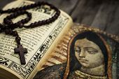 stock photo of rosary  - A Religious concept of a rosary and a bible on wood background - JPG