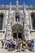 Lisbon, Portugal - June 30, 2013: a guided tour for tourists observing the South Portal of the Jeron