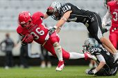 INNSBRUCK,  AUSTRIA - MAY 25 DB Markus Krause (#21 Raiders) tackles RB Alexander Kuronen (#36 Rooste