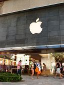 Tourist Walk By Waikiki Apple Store At The Famous Shopping Center The Royal Hawaiian