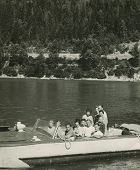 SUDAK, UKRAINE, USSR - CIRCA 1970s : An antique photo shows group of Russian tourists boating.