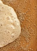 Rising Yeast Dough on wooden table surface top view background
