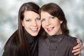 Happy mature mother portrait together with adult daughter
