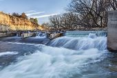 river dam diverting water for farmland irrigation, Cache la Poudre RIver in Fort Collins, Colorado,