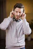Attractive Young Man Listening To Music On Headphones, Eyes Closed