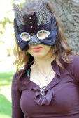 picture of catwomen  - Young beautiful caucasian girl wearing a cat mask.
