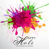 Indian festival Happy Holi celebrations concept on colours splash background with stylish text.