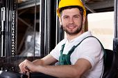 Storehouse Worker On Forklift