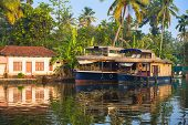 Reflection Houseboat And House In Kerala Backwaters, India