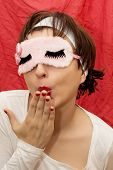 Attractive Woman In Sleep Mask Sending Kiss