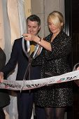 NEW YORK-JAN 28: (L-R) Jeffrey Fowler and Cameron Diaz attend a ribbon cutting at the Tag Heuer Flag