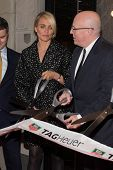 NEW YORK-JAN 28: (L-R) Cameron Diaz and CEO of TAG Heuer Stephane Linder attend a ribbon cutting at