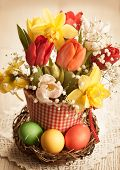 Vintage Bouquet of spring flowers and easter eggs for Easter