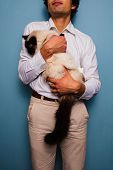 Young Man Holding Birman Cat