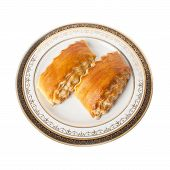 Two pieces of Armenian traditional cake Gata on a plate with ornament isolated over white