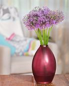Giant Onion (allium Giganteum) Flowers In The Flower Vase On Table