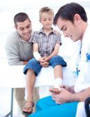 Doctor Bandaging A Child's Foot