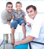 Doctor Checking A Boy Reflexes
