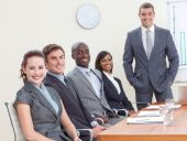 Businessteam In A Meeting Analyzing Profits And Taxes