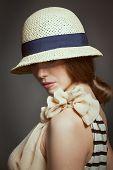 Stylish Woman In Retro Wicker Hat