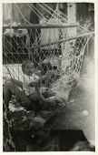 MOSCOW, USSR - CIRCA 1970s : An antique photo shows young mother and her baby resting in a hammock.