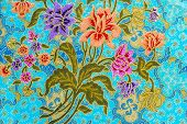 foto of batik  - Beautiful colorful flowers pattern on batik background - JPG