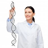 healthcare, medical and technology - young female doctor writing dna molecule in the air