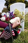 American Flag And Headstones At United States National Cemetery